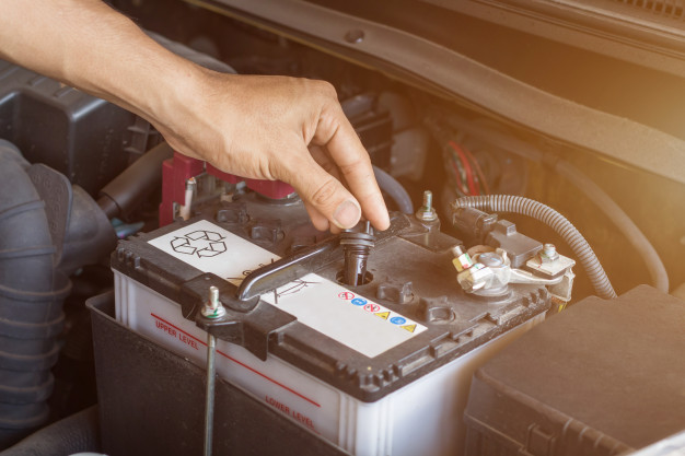 auto-mechanic-working-check-system-water-battery-fill-old-car-engine-service-station-change-repair-before-drive_38161-1227